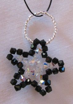 Black and crystal Christmas star pattern