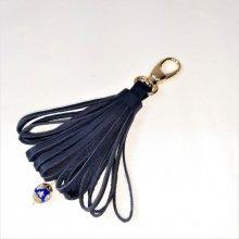 Bijou de sac pompon cuir de vachette coloris bleu marine perle Murano..