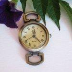 Antique bronze round watch face