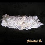 jarretière mariage dentelle blanche et papillon d'argent