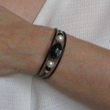 bracelet manchette noir et blanc sur silicone noir