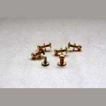 boutons de col à vis dorés