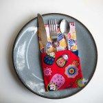 36- Serviette de table 33x33cm, ton rouge/poupées russes